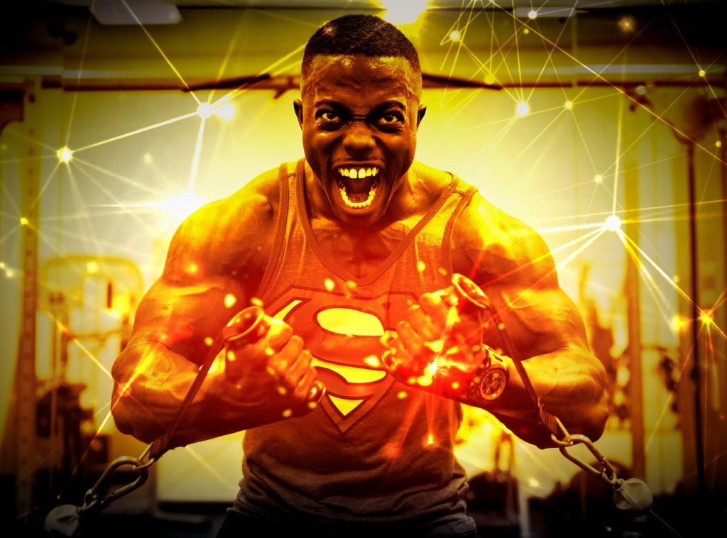 bodybuilder cable machine chest reps superman black man